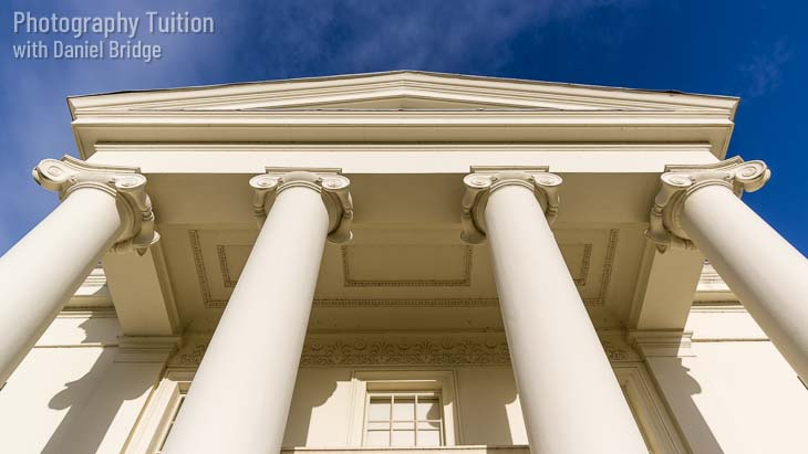 Fancy neo-classical house frontage with ionic columns.